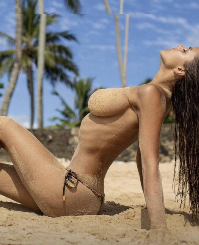 Vicky Odintsova nude on the beach, showing a sexy figure