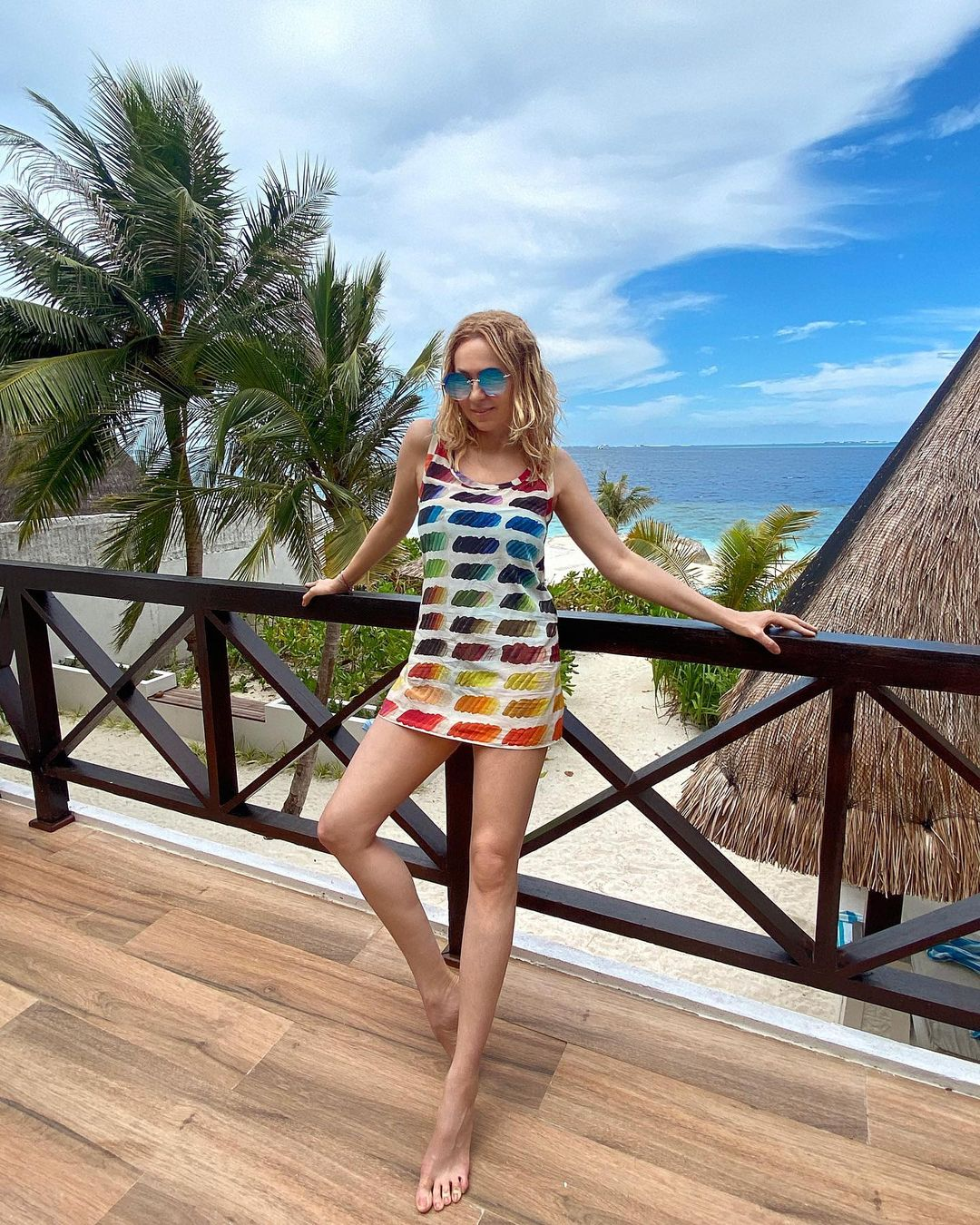 Yana Rudkovskaya on vacation demonstrates her long legs in a short dress