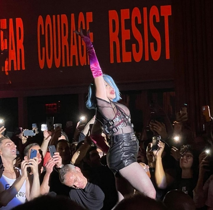 Madonna in leather shorts and bare breasts staged a show in a gay club