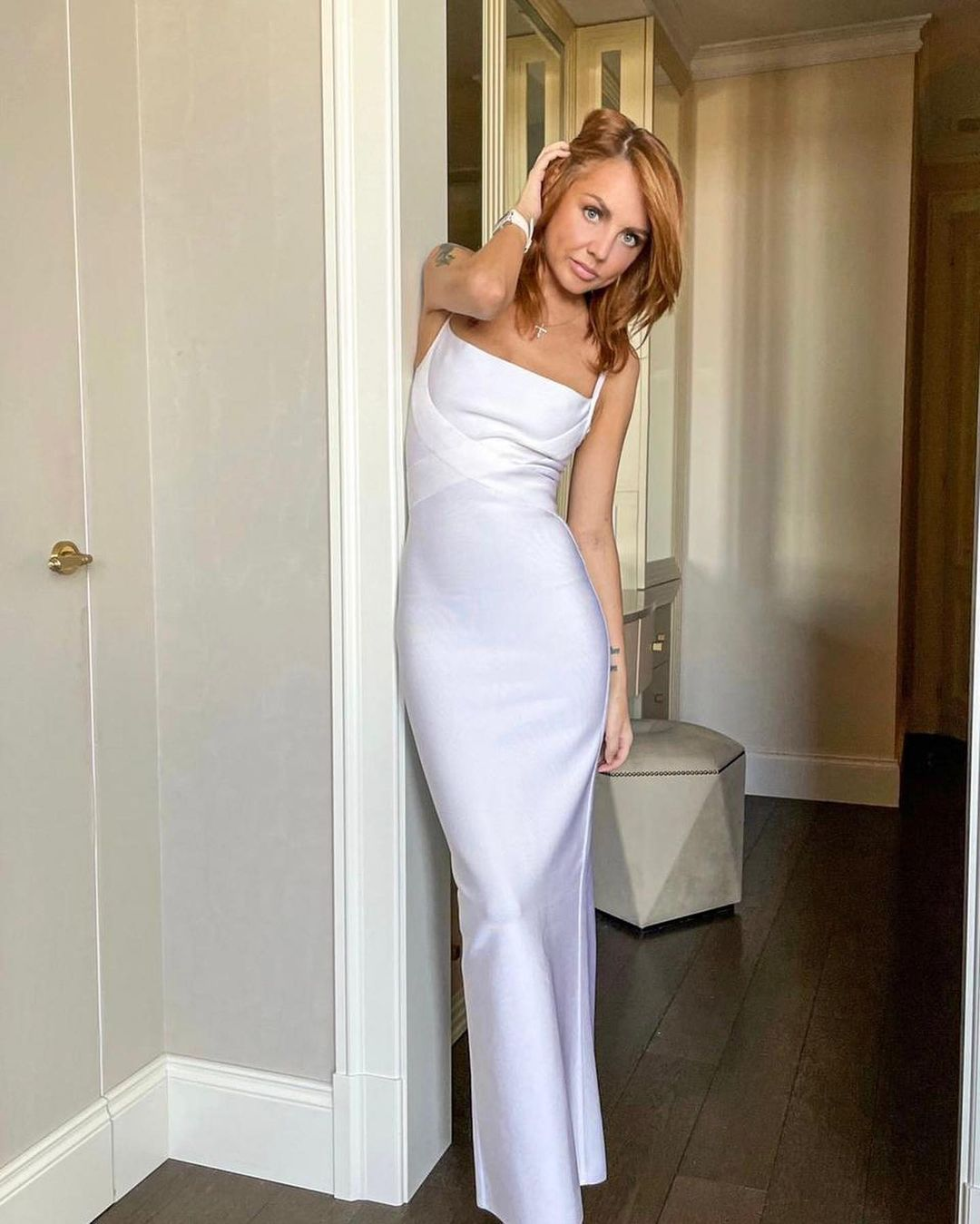 Singer MakSim arranged a photo shoot in a white dress, highlighting her thinness