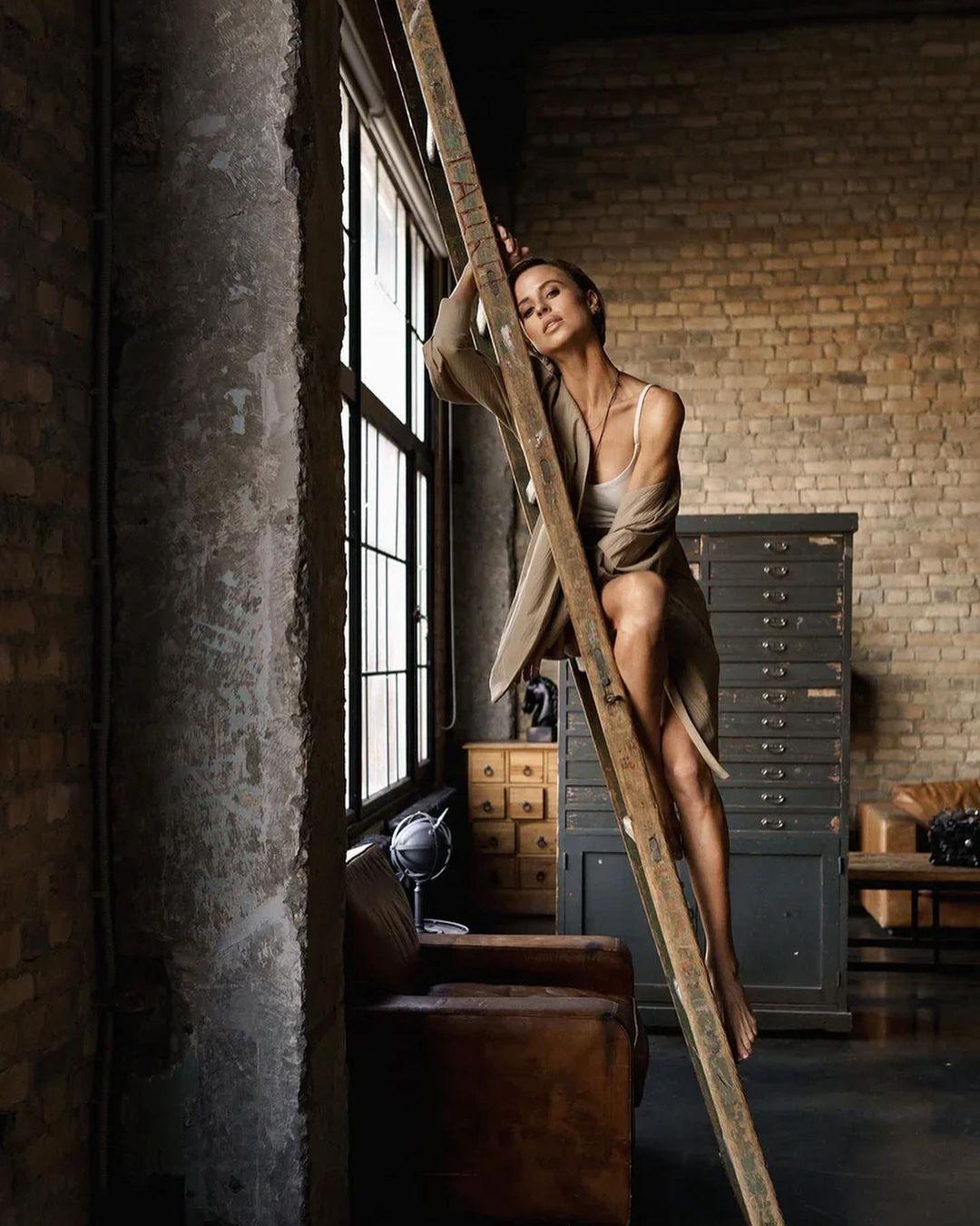 Miroslava Karpovich starred in a sensual photo shoot hugging the stairs